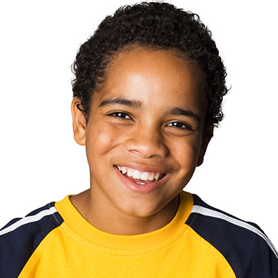 A young boy smiling